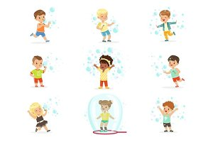 Cute little girls and boys blowing and playing soap bubbles