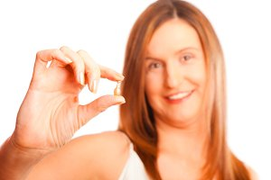 Anti-ageing Concept: Woman In Her Forties With Youth-pills