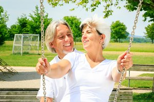 Senior Couple Having Fun On The Playground