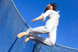 Woman Juming On Trampoline