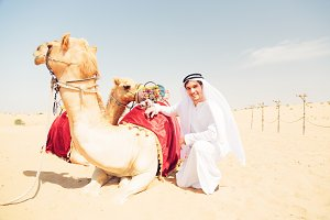 Young Arabian Man With His Camels