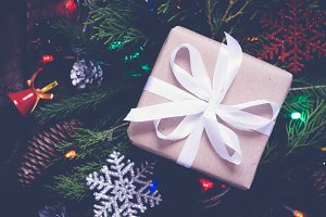 Festively gift box on dark decorated christmas background