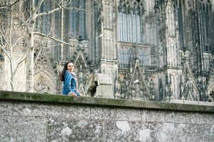 Young Woman In Front Of Cologne's Cathedral