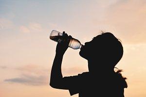 Silhouette women drinking water