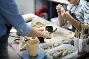 Artists in a pottery studio