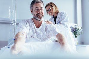 Mature man sitting in hospital bed