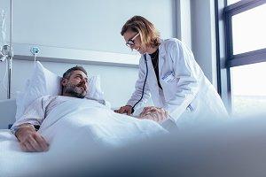 Doctor examining patient pulse
