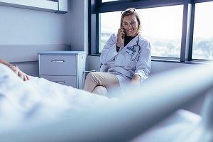 Doctor sitting in hospital ward
