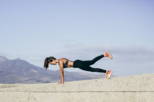 Muscular woman doing core exercise