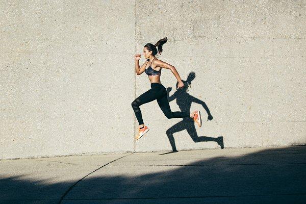 Sportswoman running and exercising