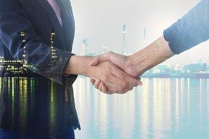 Double exposure business handshake