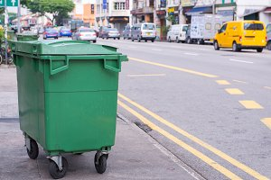 Green recycling bin container
