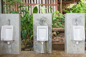 Urinals Men public in toilet room