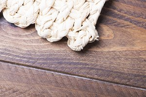 Wicker fabric background on wooden table. Texture.