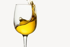 Glass of white wine with splash