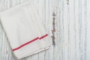 Linen kitchen towel over grunge baking tray