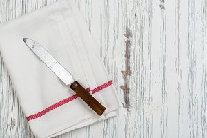Linen kitchen towel and knife