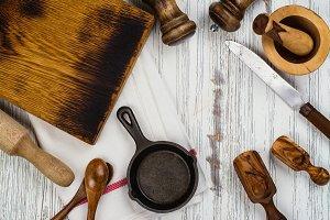 Kitchen utensils on white wooden table