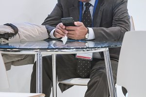 Businessman working with smartphone at table