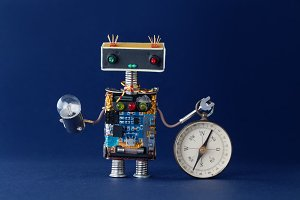 Friendly robot with magnetic exploration compass and light bulb lamp. Navigating looking for journey concept. Blue background.
