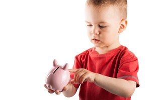 Children with money box pig