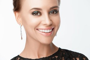 Beautiful smiling woman with evening make-up. Jewelry and Beauty. Fashion photo
