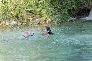 Teenager bathing in a lake