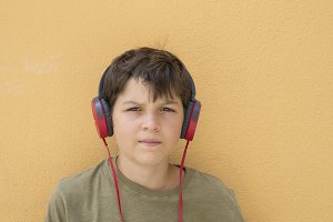 Young skater with headphones
