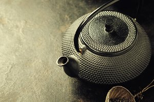 Teapot on vintage background
