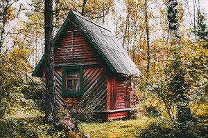 Small wooden cabin in autumn forest