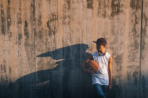 Young boy with basket ball and cap