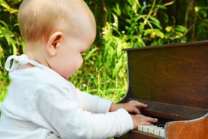 plays toy piano