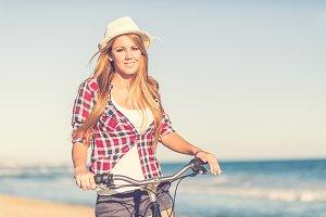Girl sitting on bike