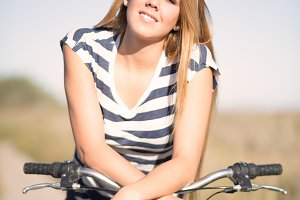 girl sitting on bike at the field