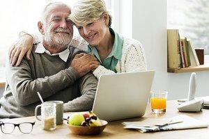 Elderly using computer laptop