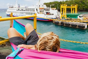 Backpacker relaxing on a ferry