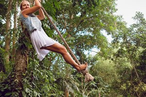 Girl have a fun on rope swing