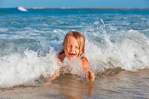 Happy child on sea beach