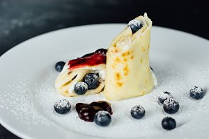 Pancakes with blueberries and jam