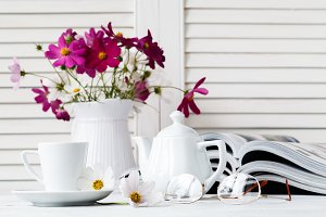 cup of tea on book with flower