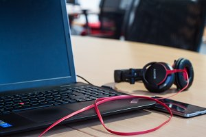 Laptop, phone, headphones