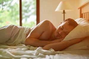 One man sleeping in bed