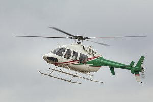 Small passenger helicopter in flight, close up