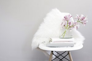 Orchids and Faux Fur on White Chair