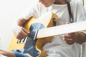 Young boy with guitar
