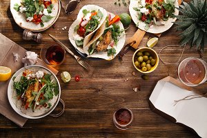 Tacos with fried avocados , tomatoes and green