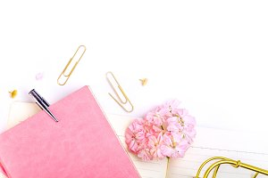 Workplace mockup with pink leather notebook flat lay
