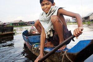 Combodian Boy on a Boat