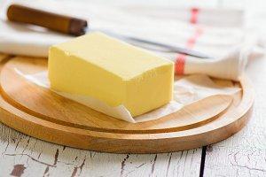Butter stick on wooden board