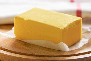 Butter block on wooden board
